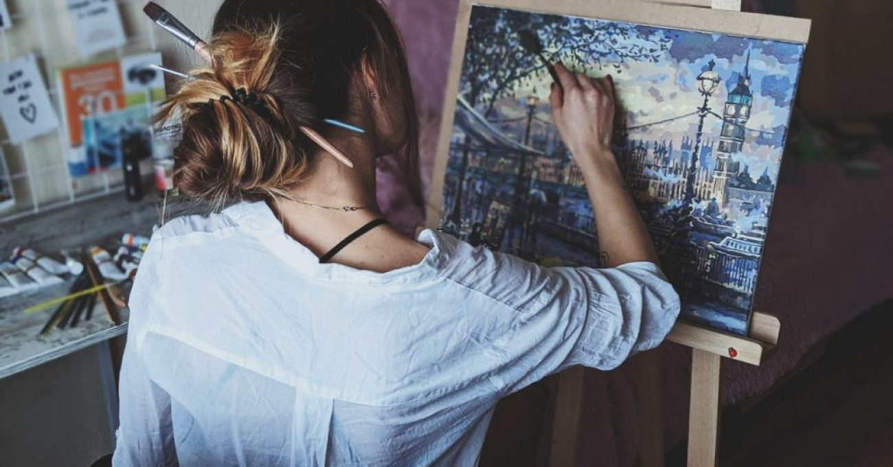 photo-of-woman-in-front-of-painting-